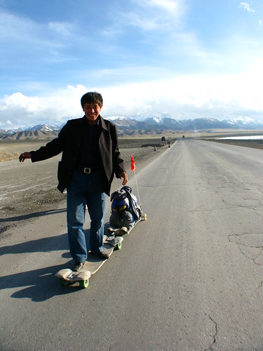 Enthusiastic local on the board near Santai, Xinjiang Province, China