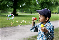Summer's Here!  [2] (*monz*) Tags: park trees boy summer portrait color colour green grass canon fun soap play bubbles dslr wingman cs3 30mm monz f14l 5dmk2 50mmf145dmk2