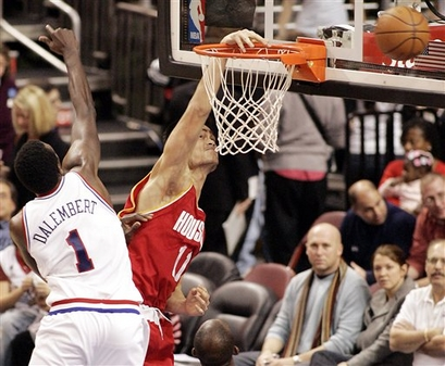 Yao Ming misses a dunk against Philadelphia in a game that was a disaster for the Rockets.  Yao only made 3-of-11 shots and scored 12 points in 33 minutes before all the starters were pulled after having fallen behind by 20+ points in the second half.
