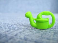 watering-can = watering-pot (Nata Nafta) Tags: macro toy toys vivid plastic wateringcan wateringpot macromarvels