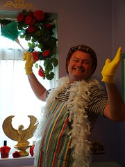 Outrageous? Me? Mystic Ed? (Mystic Ed & Fluffy) Tags: gay smiling laughing fun happy funny wizard multicoloured housework laughter geraniums clowning psychic isis outrageous mystic aprons bold overthetop daring unafraid curlers featherboas gayman haircurlers mysticed marigoldgloves