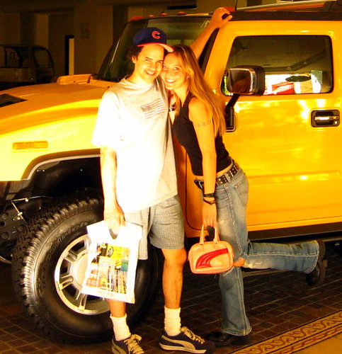 karisa and tony pierce in front of his old hummer at the grove in hollywood california