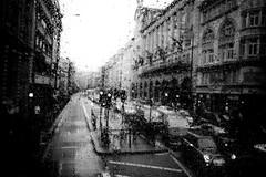 London Days (mgratzer) Tags: street blackandwhite bw white black london cars rain traffic showonmysite