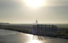 winter in Holland (ei) Tags: winter holland ice water windmill dutch field fence nederland meadow wei polder veld molen hek sloot ijs