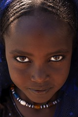 Young Afar Tribe Girl, Assaita, Afar Regional State, Ethiopia (Eric Lafforgue) Tags: africa portrait people face vertical photography necklace day child african culture tribal headshot innocence females tradition ethiopia tribe ethnic oneperson tribo frontview confidence traditionalculture hornofafrica ethnology ethiopian afar eastafrica thiopien etiopia ethiopie traditionalclothing realpeople etiopa colorimage  traveldestination danakil etiopija 1people pastoralist ethiopi 89years  africanculture onegirlonly etiopien etipia  etiyopya    asaita  assayta      a700701