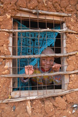 Happy Kid inside Kibera Slum, Kenya (Stephen G Woo Photo journey) Tags: africa toronto canada kids children photography photo kid photographer child pentax kenya african g steve photographic woo stephen safari photograph mara production director base masai kibera slum   k10d gurie stephenwoo   stephengwoo sgwoo