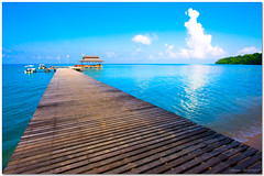 Welcome to Paradise (Chee Seong) Tags: trip summer vacation beach clouds canon boats island pier diving east malaysia sabah kk survivorisland canon1022mm blueribbonwinner pulautiga 400d anawesomeshot impressedbeauty