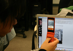 Japanese Visitor Shows QR Code Ready Mobile Ph...