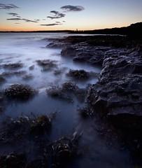Round the Rugged Rocks (Steve Castle) Tags: longexposure sea wales docks geotagged island evening coast rocks dusk shore barry slowshutter moonlight docklands lowtide sully tidal penarth causeway valeofglamorgan lastlight bristolchannel stevecastle sigma1020 sullyisland 40d geo:lat=51394701 geo:lon=3200895