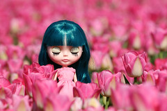 Madison with closed eyes and pink tulips