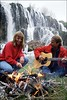 couple sitting around campfire playing guitar, Water fall, Swan Valley Idaho