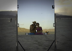Mirror... and (Rekanyari) Tags: sunset love mirror sand couple burningman hmmmm greenman 2007 blackrockdesert