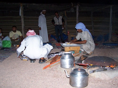 The Bedouin men cooking