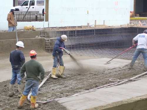 concrete being poured for the pool