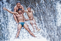 Water Fun series -  the Abangan Barong kids (Mio Cade) Tags: boy shirtless portrait bw white black cute water leaves fun photography canal leaf kid bath village child enjoy performer barong swin abangan