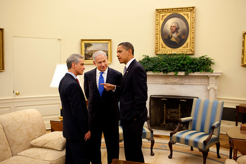 Obama talking to his aide while Netanyahu listens - official White House photo on 18 May 2009