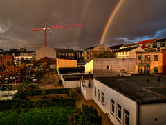 October (Peter Rosbjerg) Tags: above city blue red rain clouds denmark rainbow october parkinglot herning crane danish danmark danskvejr