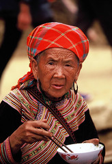 VIETNAM (BoazImages) Tags: life old food woman flower face topv111 lunch colorful asia vietnam chopsticks miao hmong documentry indiginous mywinners aplusphoto boazimages naturalbeautyportraiture