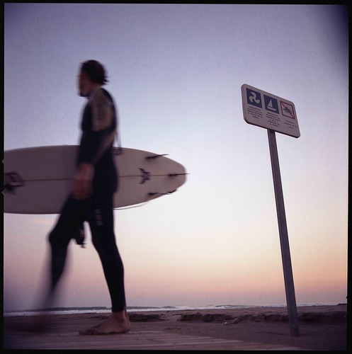 winter surfer - copyright Edward Olive photographer fotografo - photo available to license in Getty Image Collection