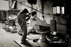 Back alley haircut (wprasek) Tags: china old blackandwhite bw brown haircut monochrome fashion work hair blackwhite back alley decay grunge working monochromatic dirty retro mo business barber ugly worn hairdresser rough macau decrepit trade rundown innerharbour singlecolor singlecolour macausar folioworkinglife warrenprasek xoodu wprasek wwwxooducom wwwwprasekcom