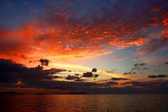 sunset (esther**) Tags: blue light sunset red sea sky sunlight reflection colors clouds golden greece topf100 rhodes interestingness2 holidaysvacanzeurlaub