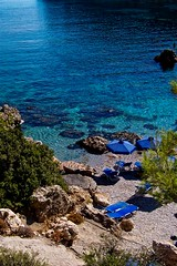 Ladiko Bay (Stefania Maria Livraghi) Tags: blue sea summer beach water rock swimming swim geotagged bay sand rocks europa europe mare estate blu explore greece grecia roccia rocce acqua rhodes spiaggia rodi nuoto sabbia rhodos baia themoulinrouge  nuotare   abigfave ladik   theperfectphotographer ladiko thegoldendreams stefyria anthonyqueenbay