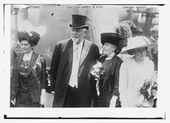 Susan Carey, Gov. J.M. Carey & wife, Dorothy Knight  (LOC) (The Library of Congress) Tags: family flowers usa white man black philadelphia floral hat america vintage dorothy grey costume women dress pennsylvania stripes formal feather hats september suit governor tophat politicians knight libraryofcongress wyoming 1912 battleship 1910s usnavy usn uss carey necklaces unitedstatesnavy philadelphiapa philadelphiapennsylvania usswyoming xmlns:dc=httppurlorgdcelements11 vandykebeard corsarge dc:identifier=httphdllocgovlocpnpggbain09239 jmcarey dorothyknight bb32 susancarey williamcrampsons may251911 wyomingclass usswyomingbb32 williamcrampandsons crampandsons josephmaullcarey josephmcarey josephcarey crampsons