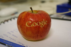 An apple with the logo of Google made with laser