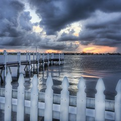 The Worn Picket Fence (Stuck in Customs) Tags: blue sunset sea sky panorama storm beach nature beautiful beauty clouds composition landscape photography nikon photographer florida unique background magic details horizon d2x perspective dream blues peaceful best palm catching processing attractive pro framing lovely palmbeach hdr trey picket treatment glamorous mostviewed fense palabra highquality bewitching mesmeric stuckincustoms treyratcliff picketfense lovesome