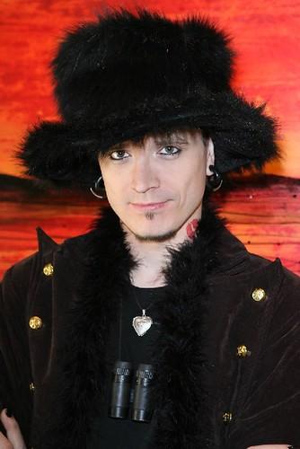 Note: The furry hat, furry boa, tattooed eyeliner, black nail polish,