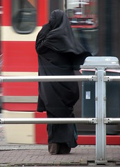 Lady in Niqaab (bogers) Tags: life street city red people urban holland netherlands dutch photo europe foto diary nederland citylife tram denhaag haaglanden daily modesty holanda niqab bas rood thehague bogers stad straat mensen ov openbaarvervoer zuidholland niqaab htm sgravenhage haags hofstad straatfotografie niederlnde basbogers 29102007 basbogersdenhaaghotmailcom straatfotografiecom