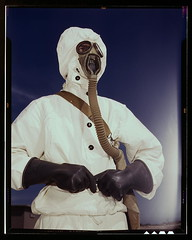 Sailor at the Naval Air Base wears the new type protective clothing and gas mask designed for use in chemical warfare, Corpus Christi, Texas. These uniforms are lighter than the old type (LOC)