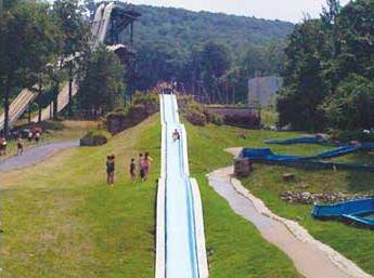 One of the long water slides, a tame one, at Action Park, Vernon, New Jersey.  From www.weirdnj.com.