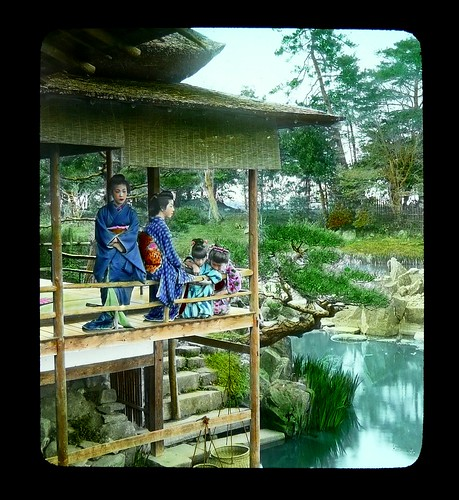 GEISHA ON VERANDA OVER POND