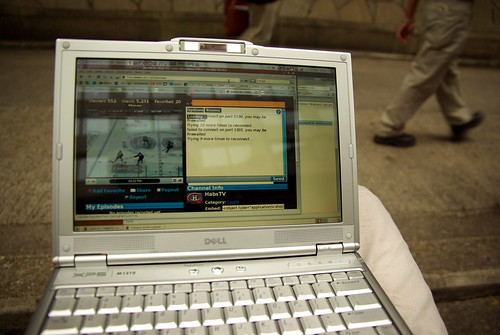 Laptop w/ streaming hockey game in HK