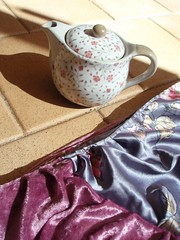 pink and grey scarf and teapot