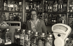 Joan in her sweet shop in 1954 (lovedaylemon) Tags: smile vintage found image 1954 scales sweetshop glassjars cashtill