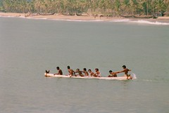 Happy young men in a canoe (bent.christiansen) Tags: trip travel sea vacation portrait people india man colour men travelling beach water portraits fun happy boat nikon funny colours kerala canoe canoes indians vacations trivandrum kovalam kovalambeach