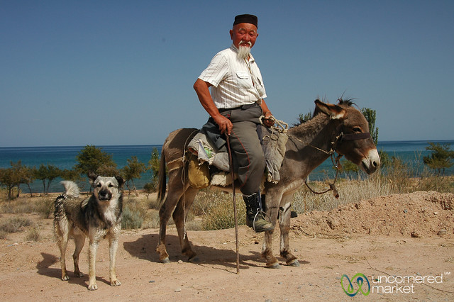 Kyrgyz man on horse at Lake Issyk-Kul