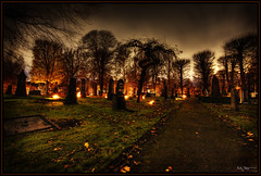 Visiting the grave (Kaj Bjurman) Tags: autumn grave night eos sweden stockholm cemetary hdr orton kaj 2007 cs3 photomatix 40d bjurman