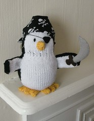 Knitted pirate penguin doll