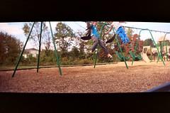 Flight of the Knuckle Heads (bigChill) Tags: noah park film playground 35mm outside jumping swings toycamera nate carolina kodakmax400 2007 expiredfilm weekendshoots vivitarvistatele file:name=20071029vivitarvistatelea10adjustedpng