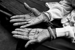 "Elderly woman hands up - Issan, Thailand (Sailing ""Footprints: Real to Reel"" (Ronn ashore)) Tags: portrait blackandwhite thailand hands women asia market elderly age issan canoneos5d canonef35mmf14lusm 4january2008buildingthetemplescaffolds nunnfire"