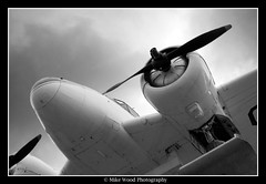 Duck! (Mike Wood Photography) Tags: vacation bw airplane eos duck aircraft arr skis allrightsreserved mikewood beech18 400d aplusphoto mikewoodphotographycom expiditor mikewoodphotography tailcfuwe builtin1944 saultsaintmarieontariocanada canadianbushplaneheritagemuseumcanadiancivilaircraftregister lotofworkforhardlyanyviews mwptrav
