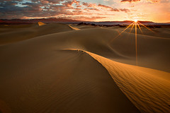 Death Valley Dunes Sunrise (KPieper) Tags: california clouds sunrise landscape sand bravo dunes curves flare deathvalley ripples ridges sunstar stovepipewells supershot nohdr mywinners platinumphoto aplusphoto diamondclassphotographer flickrdiamond kevinpieper kpieper pieperphotographynet absolutelystunningscapes