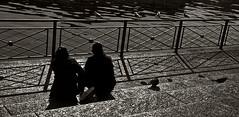 Looking for... (edouardv66) Tags: bw woman man water river switzerland blackwhite nikon couple suisse geneva gull femme bank nb d200 genve 18200 vr homme berges noirblanc rhone granit blacklighting backllit