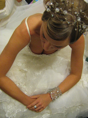 This is a crystal beaded headband tiara that wraps around the bride's head