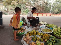 The Customer (Chiradeep.) Tags: streetphotography street child fruits calcutta kolkata westbengal india huawei honor5c