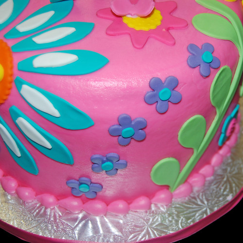 3rd birthday colorful floral patterned cake closeup view