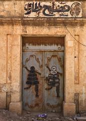 Michelin in Libya (Eric Lafforgue) Tags: africa door shop northafrica hasselblad libya michelin tyres bibendum pneus libia libye libyen ghadafi h3d  lbia 14582 lafforgue italiancolony jamahiriya libi libiya  ribia liviya khadafi libija ptolmas       lbija  lby  libja lbya liiba livi